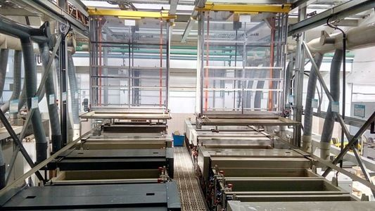 Automatic double line for the application of galvanic zinc and cadmium on steel hinges.
